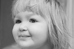 Smiling baby girl's portrait. Cute baby girl's portrait. black and white photography royalty free stock image