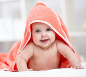 Smiling baby girl after shower or bath with towel on head Royalty Free Stock Photography