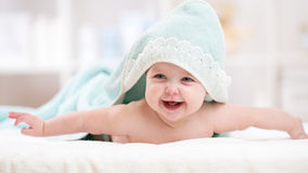 Smiling baby girl after shower with towel on head Stock Image