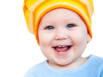 Smiling baby girl showing teeth wearing a  hat Royalty Free Stock Photos