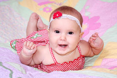 Smiling baby girl in summer dress Royalty Free Stock Photography