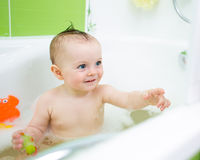 Smiling baby girl taking bath Stock Image