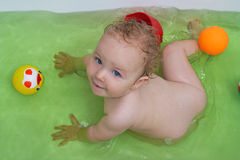 Smiling baby girl taking bath Royalty Free Stock Photo