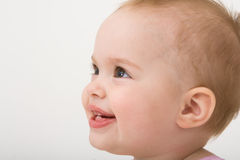 Smiling baby girl, toddler. Isolated on the white background Royalty Free Stock Images