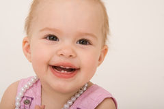 Smiling baby girl, toddler. Isolated on the white background Stock Photos