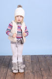 Smiling baby girl in warm sweater and hat Royalty Free Stock Photography