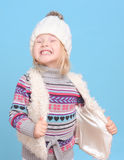 Smiling baby girl in warm sweater and hat Royalty Free Stock Photo