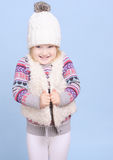 Smiling baby girl in warm sweater and hat Stock Image