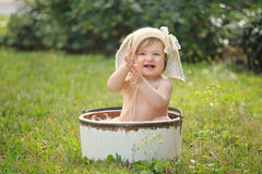 Smiling Baby Girl Wearing a Bunny Bonnet Stock Images
