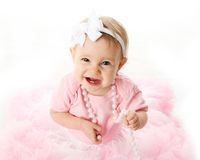 Smiling baby girl wearing pettiskirt tutu Stock Photo