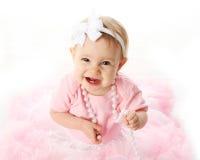 Smiling baby girl wearing pettiskirt tutu Stock Photo