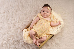 Smiling Baby Girl Wearing a Yellow Romper Royalty Free Stock Photos