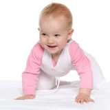 Smiling baby girl on the white towel Royalty Free Stock Photography