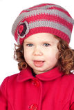 Smiling baby girl with wool cap Royalty Free Stock Photos