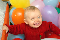 Smiling baby with globes royalty free stock photo