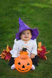 Smiling baby halloween witch. Adorable smiling baby wearing seasonal halloween costume with witches hat Stock Images