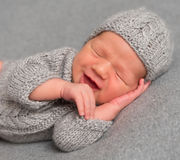 Smiling baby in a hat asleep Royalty Free Stock Images