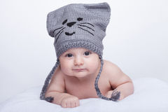 Smiling baby in a hat. Boy in cap smiling and looking in camera Stock Image