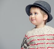 Smiling baby in hat isolated on grey background Stock Photos