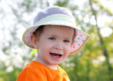 Smiling baby in hat outdoor Royalty Free Stock Images