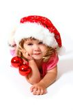 Smiling baby with hat of Santa and balls Royalty Free Stock Images