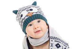Smiling baby with hat and scarf in studio Stock Photos