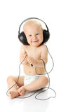 Smiling baby with headphone Royalty Free Stock Image