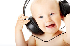 Smiling baby with headphone Stock Images