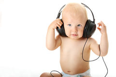 Smiling baby with headphone Royalty Free Stock Photos