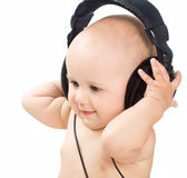 Smiling baby with headphone Stock Photography