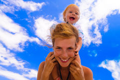 Smiling baby with her mother stock photos