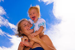 Smiling baby with her mother Stock Images