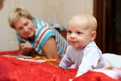 Smiling baby with his grandmother Royalty Free Stock Photo