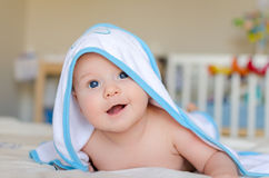 Smiling baby in a hooded towel after bath Stock Photography