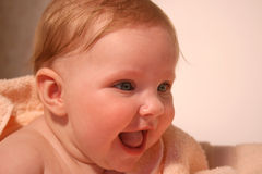 Smiling Baby In Bath Towel Stock Photography