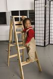 Smiling baby on a ladder Stock Photos