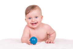 Smiling baby lie on towel Stock Photo