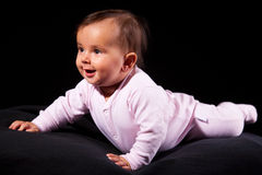 Smiling baby lies Stock Images