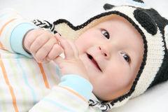 Smiling baby lies on back Stock Photo