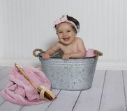 Smiling baby in little bath tub royalty free stock photos