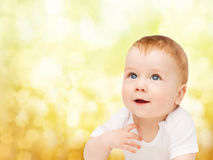 Smiling baby looking up. Child and toddler concept - smiling baby looking up Stock Images