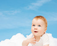 Smiling baby looking up Stock Photos