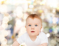 Smiling baby looking up. Child and toddler concept - smiling baby looking up Royalty Free Stock Images