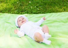 Smiling baby lying on floor and looking up Stock Image