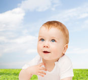 Smiling baby lying on floor and looking up Royalty Free Stock Photos