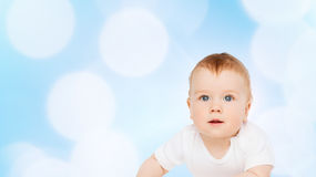 Smiling baby lying on floor and looking up Stock Photos