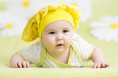 Smiling baby lying on green Royalty Free Stock Image
