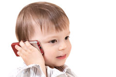 Smiling baby with mobile phone royalty free stock image