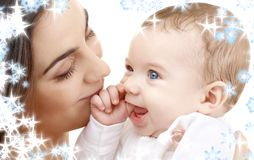 Smiling baby in mother hands Royalty Free Stock Image