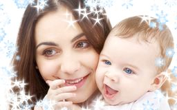 Smiling baby in mother hands Stock Images